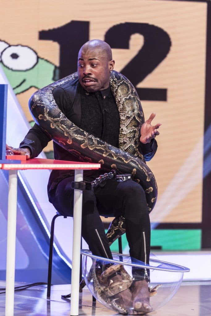 Darren puts his bravery to the test with some snakes.